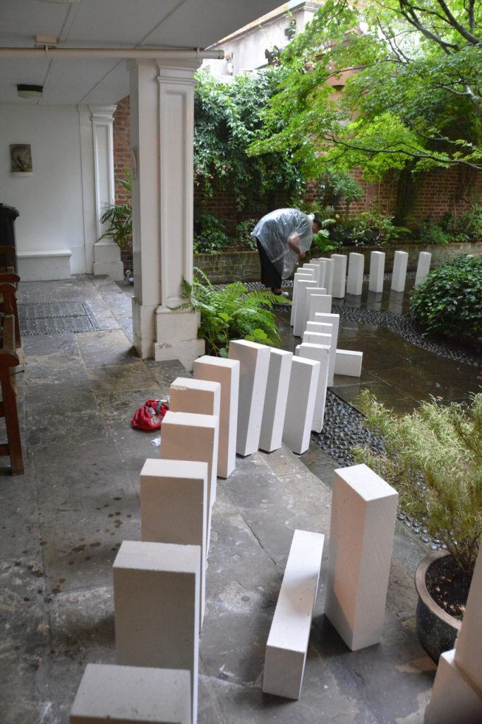 """Setting up: The breeze block """"dominoes"""" get set up for the Great Fire of London 350-year commemorations. Photo © Barry Hamilton."""